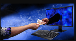 a hand coming out of a laptop exchanging money with another hand