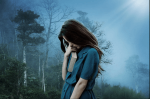 young girl, blue dress, sad with head down, gloomy forest in the background