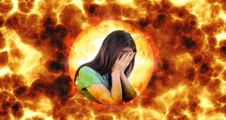 girl in a green t-shirt, face in her hands, surrendered by fire flames, stressed, burnout, insane