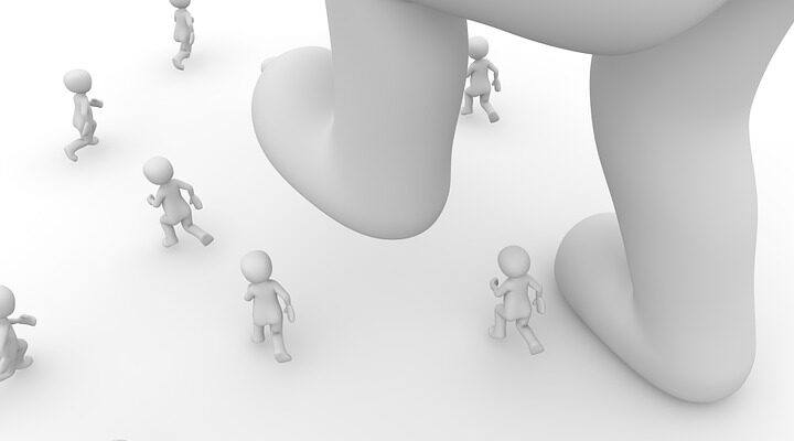 big figure crashing small figures with a leg. Dealing With Toxic Work Environment - The Hard Truth